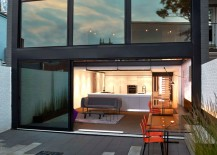 Massive glass windows and sliding doors open up the rear to the garden