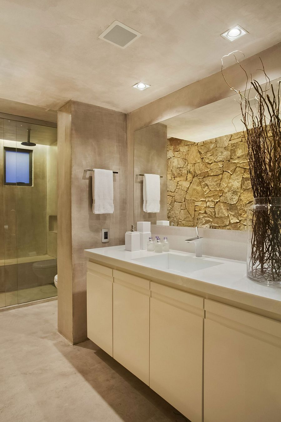 Master bath with stone and concrete walls