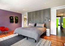 Master-bedroom-with-concrete-accent-wall-217x155