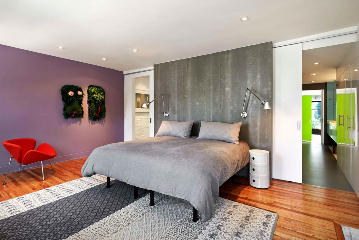Master bedroom with concrete accent wall