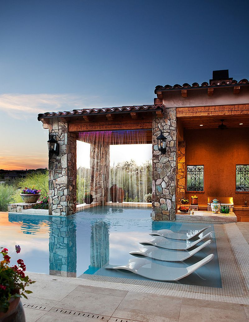 Mediterranean style pool area with waterfall features a hidden wonder [Design: Beringer Fine Homes]