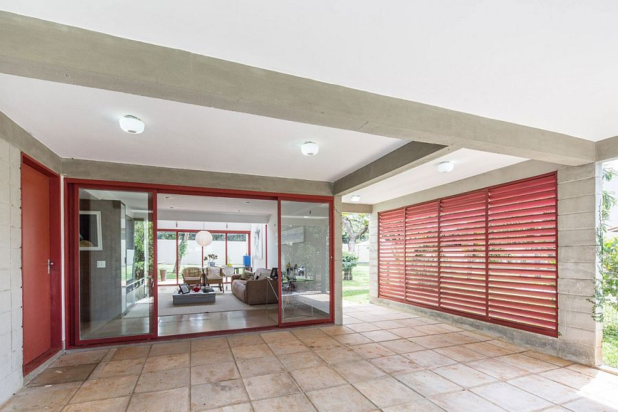 Metallic frame and windows in red add a punch of color to the interior