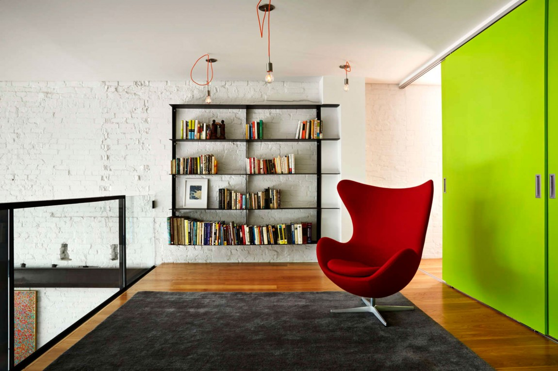Mezzanine level with bookshelf and comfy Egg Chair