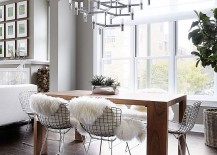 Minimal dining room table, smart chandelier and plush textures shape a stunning dining room