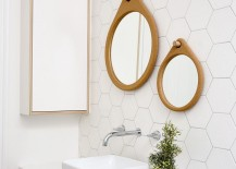 Mirror frames and vanity bring elegance to the white bathroom