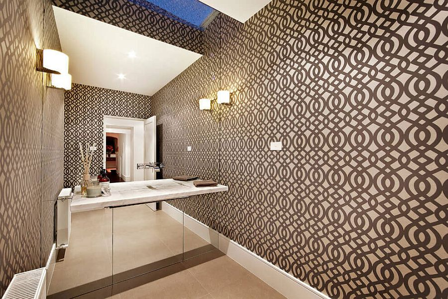 Mirrored wall and wallpaper create a spacious look in the bathroom