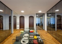 Mirrored-wardrobe-doors-and-a-central-island-for-the-lavish-walk-in-closet-217x155