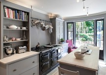 Mixed cabinet styles coupled with open gray shelves give the kitchen a modern appeal