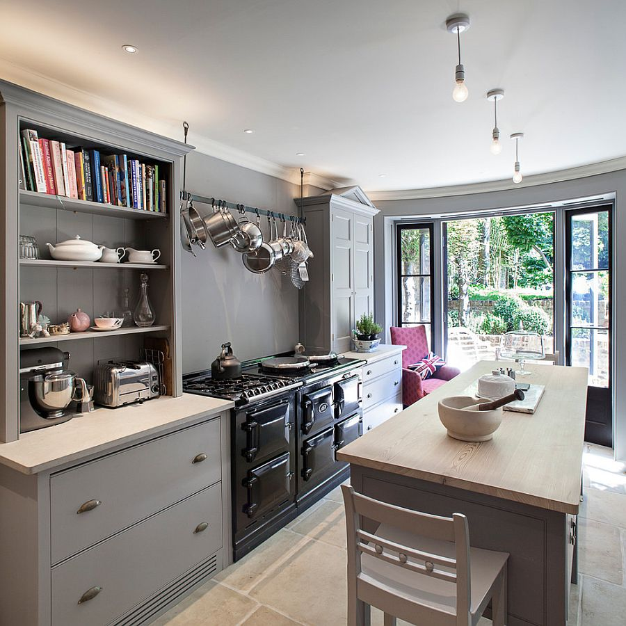 Mixed cabinet styles coupled with open gray shelves give the kitchen a modern appeal [Design: Russell Taylor Architects]