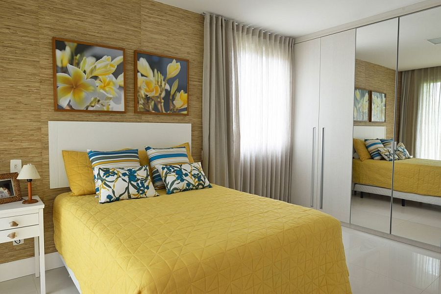 Modern bedroom with mustard yellow and blue accents