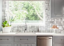 Modern classic kitchen in cool gray features a fabulous tiled backdrop [Design: Modern Nest]