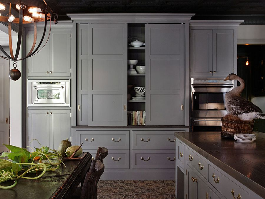 Modern kitchen hutch in gray with sliding doors [Design: HSH Interiors]