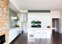 Modern-kitchen-in-white-with-stone-wall-fireplace-and-217x155