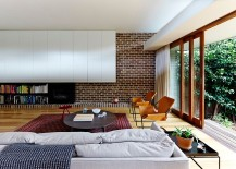 Modern-living-room-mixes-brick-wall-with-contemporary-shelves-in-white-217x155