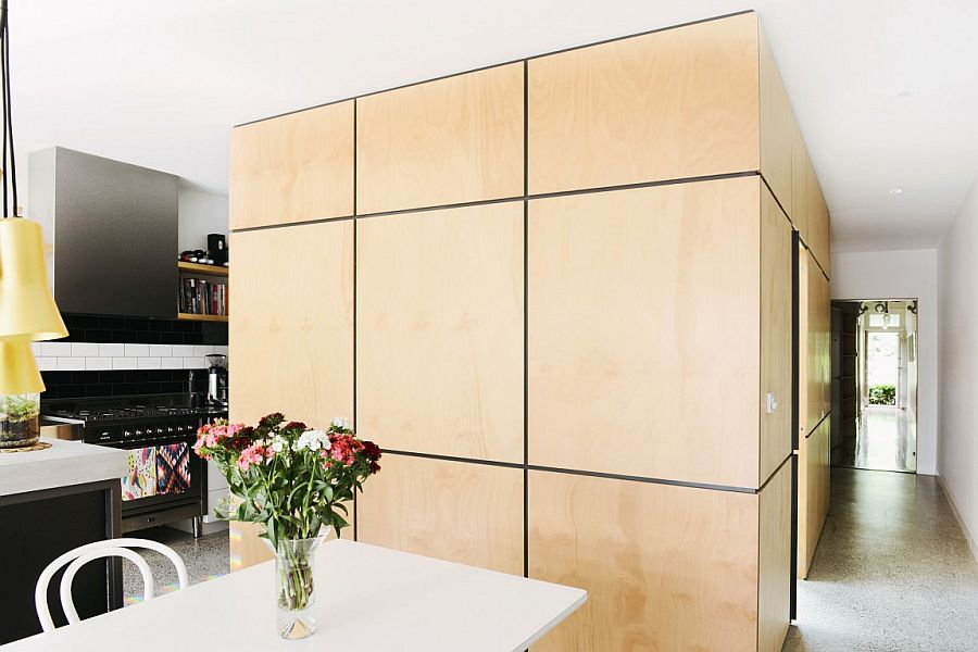 Multi-facated ply clad cabin built next to the kitchen also houses the pantry