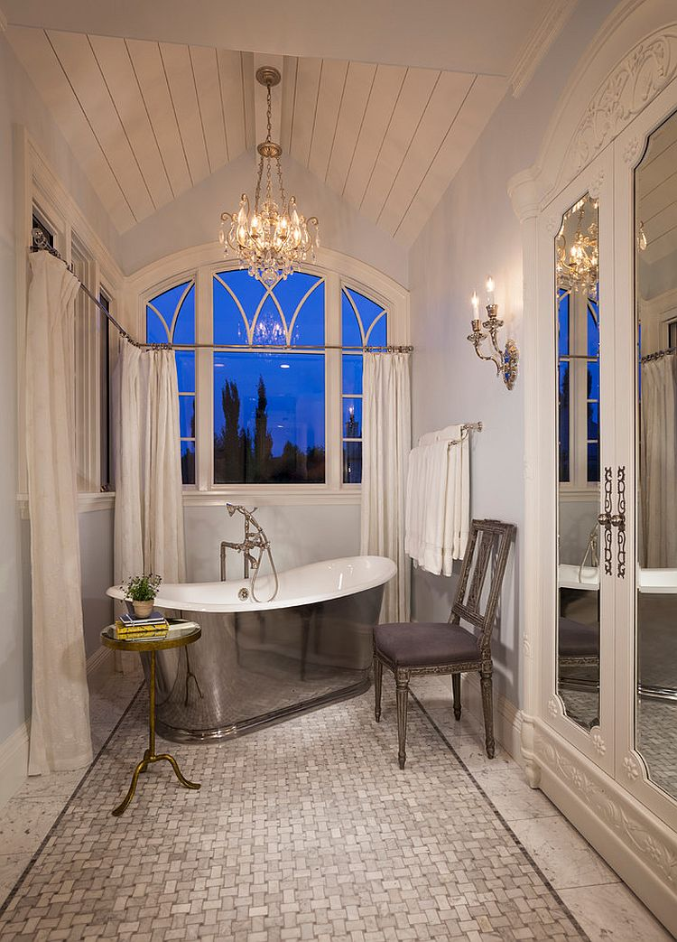 Narrow Victorian bathroom with stainless steel bathtub, chair and a sleek side table [Design: THINK architecture]