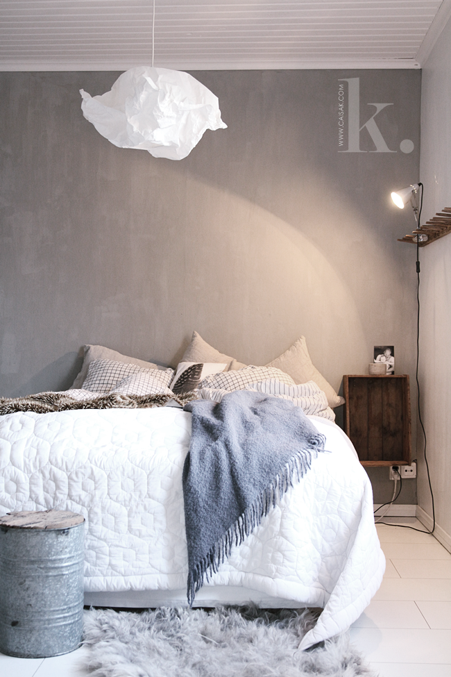 Neutral bedroom with cloud-like light fixture