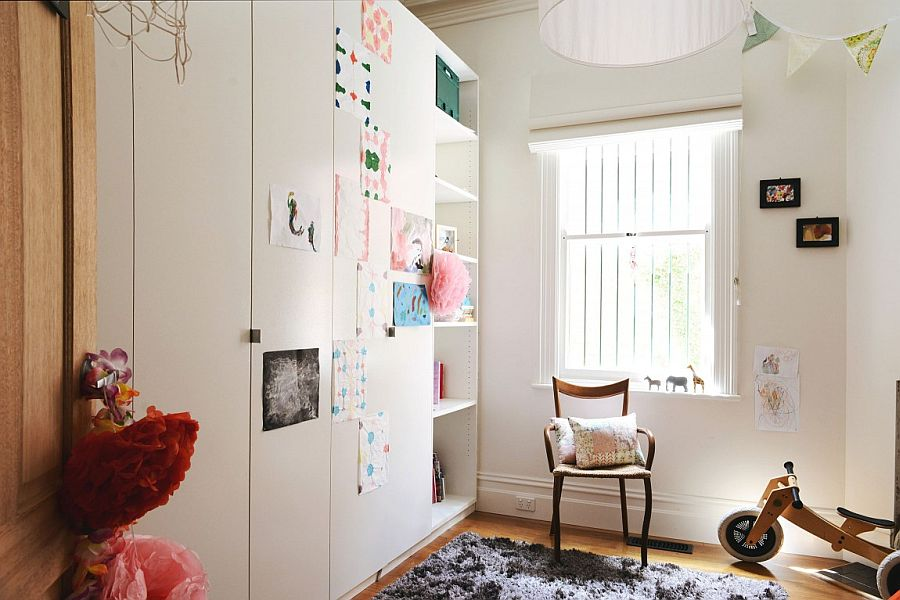 Neutral color scheme gives the small room a more spacious look