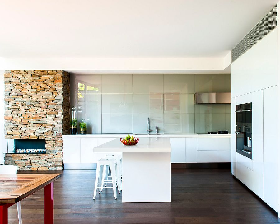 Neutral color scheme punctuated by hot accent hues fashion a trendy interior