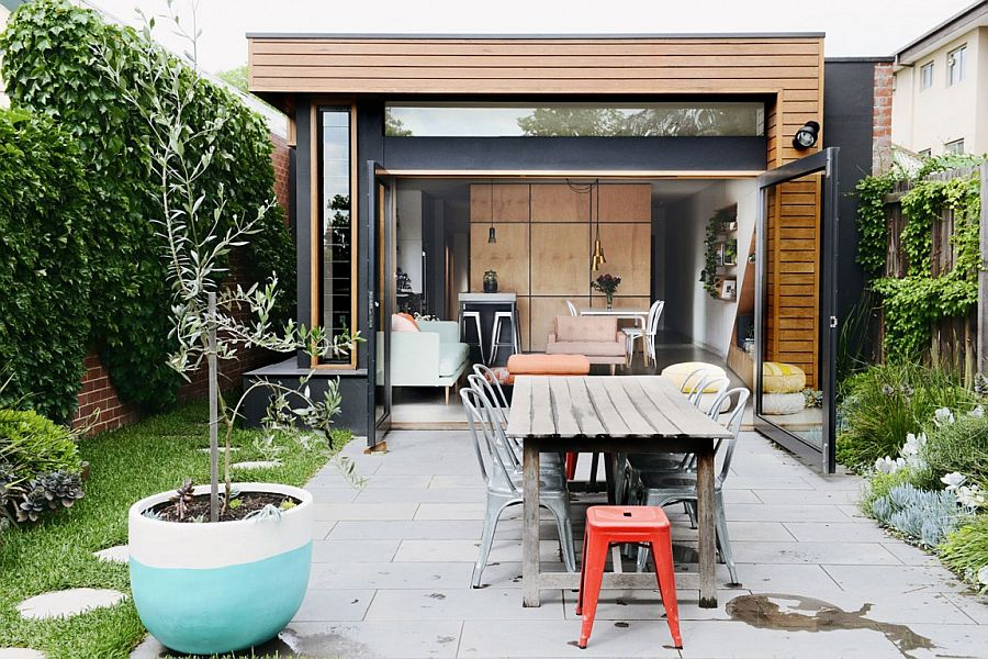 Cool central pod and a cheerful living space revive dreary for Cool house additions