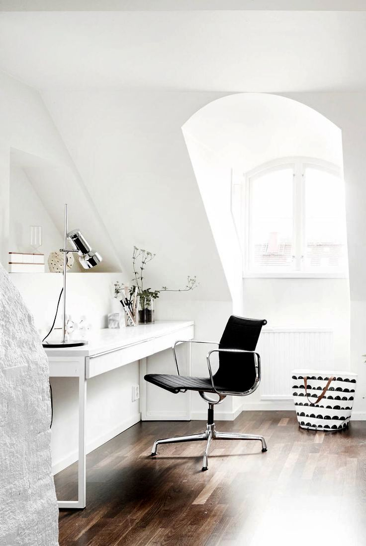 Office area beside a beautiful and bright attic window