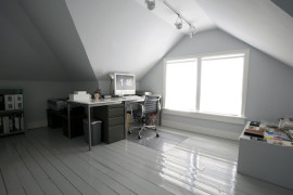 Office desk next to a huge attic window  15 Bright Attic Spaces for an Office or Studio Office desk next to a huge attic window 270x180