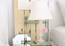 Old chair, vintage door and lovely lamp make the bedside area a shabby chic delight
