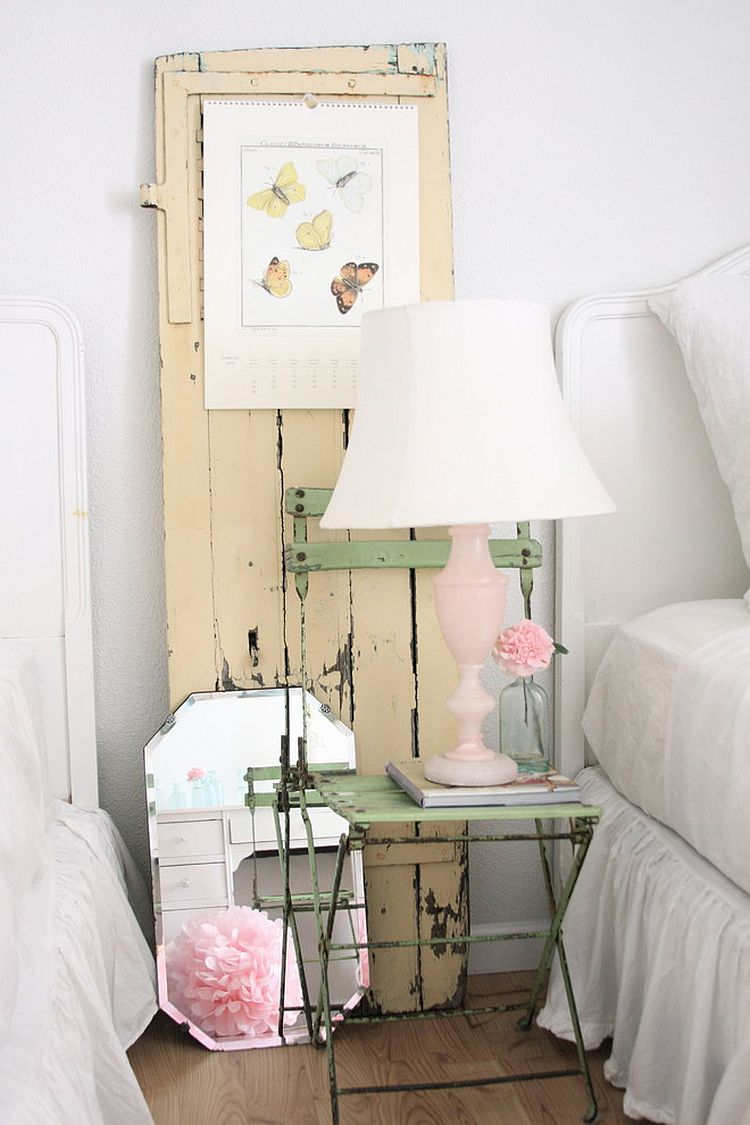 Old chair, vintage door and lovely lamp make the bedside area a shabby chic delight [From: Dreamy Whites]