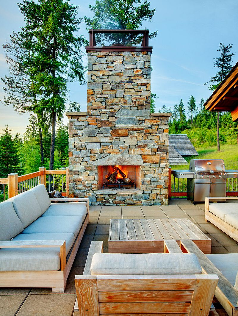 Open deck design with plush furniture and cool stone fireplace [Design: McKinney Group]