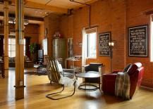 Open floor plan living area of industrial home in Edmonton [Design: AMR Interior Design & Drafting]