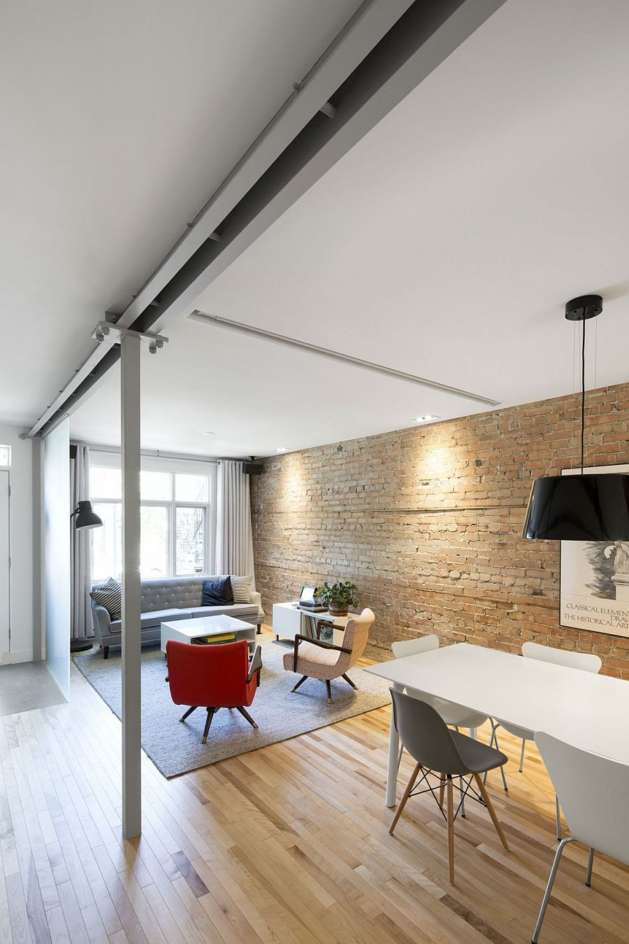 Original brick wall of the renovated 1924 building in quebec Sensible Styling: Breezy Remodel of Apartment Set in 1920s Building