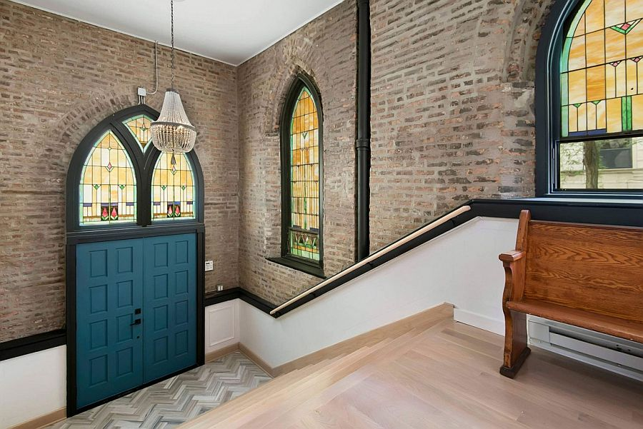 Original stained glass windows and exposed brickwork of the renovated church home