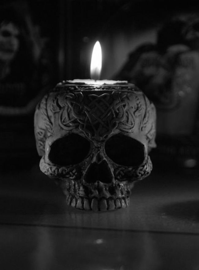 Ornate black skull candle holder