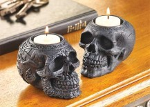 Ornate stone skull candle holders