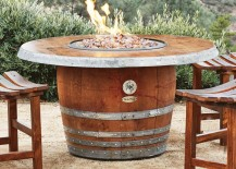 Outdoor fire pit made from an old wine barrel
