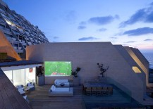 Outdoor movie night on the deck for the contemporary, urban home