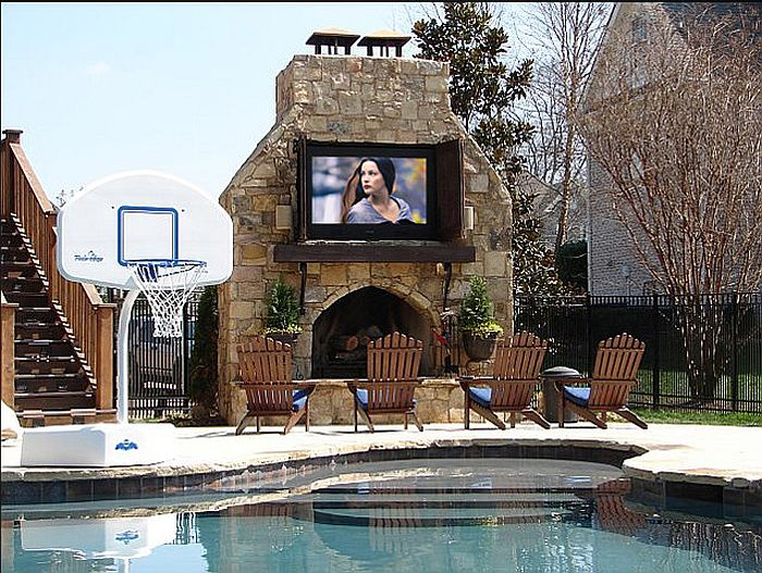 Outdoor movie zone next to the pool [Design: Creative Sights N Sounds]