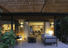 Outdoor sitting zone of the elegant Spanish home under the wicker pergola