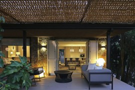 Outdoor sitting zone of the elegant Spanish home under the wicker pergola  Wicker and Metal Pergola Transforms Mountain Guest House in Barcelona Outdoor sitting zone of the elegant Spanish home under the wicker pergola 270x180