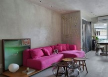 PInk sofa adds color to an otherwise neutral apartment with concrete walls 217x155 Chic Décor and Concrete Walls Welcome You at Snazzy Ipanema House