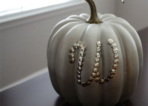 Painted pumpkin decorated with thumbtacks