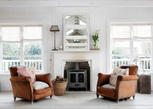 Pair of weathered leather armchairs make all the difference in this living room