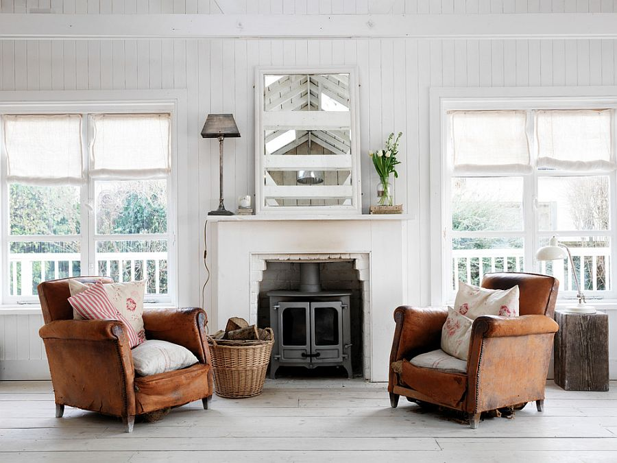 Pair of weathered leather armchairs make all the difference in this living room [Design: Cabbages & Roses]