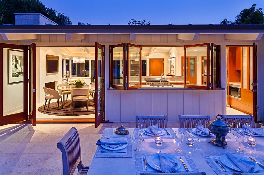 Pass-throughs connect those in kitchen with the alfresco dining