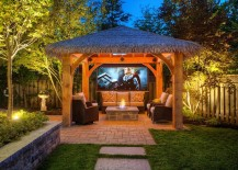 Patio with tropical style hut that is the perfect for outdoor movie night