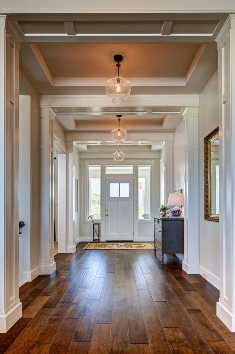 Pendant lighting in a hallway with a recessed ceiling