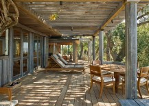 Pergola-structure-and-natural-canopy-offer-ample-shade-for-the-outdoor-lounge-217x155