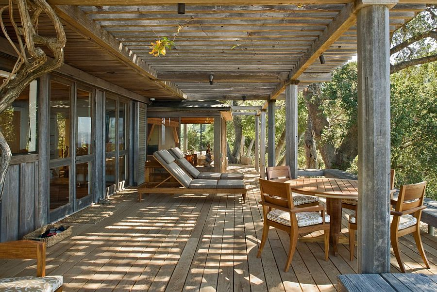 Pergola structure and natural canopy offer ample shade for the outdoor lounge