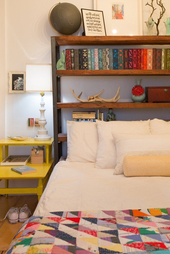 Place a bookshelf behind a bed instead of a headboard