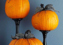 Plain pumpkins with ribbon and candlesticks